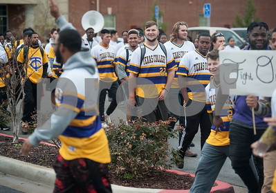 Texas College students march from the band hall to the Steer Walk for a ceremony on campus in celebration of Martin Luther King Jr. on Thursday Jan. 11, 2018 in Tyler. The ceremony advances Martin Luther King Day, a federal holiday that is held on the third Monday of January each year.  Texas College is an accredited historically black four-year college located in Tyler.  (Sarah A. Miller/Tyler Morning Telegraph)