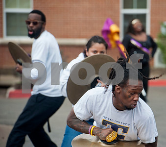 Texas College marching band cymbal players Ladarius Manning, Alexandra Martinez and Ronald Wesley dance while playing their instruments at a ceremony on campus in celebration of Martin Luther King Jr. on Thursday Jan. 11, 2018 in Tyler. The ceremony advances Martin Luther King Day, a federal holiday that is held on the third Monday of January each year.  Texas College is an accredited historically black four-year college located in Tyler.  (Sarah A. Miller/Tyler Morning Telegraph)