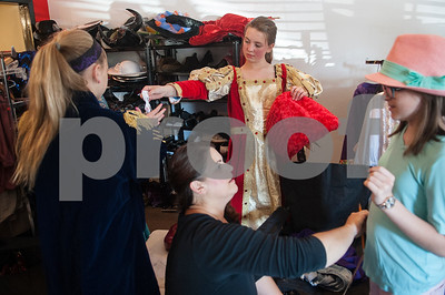 Mary Hopson, 10, background, tries on her Queen of Hearts costume for the play Alice in Wonderland Jr. at Caldwell Elementary in Tyler Oct. 29, 2016. Caldwell Fine Arts Academy is presenting Alice in Wonderland Jr. Thursday Nov. 17 at  10 a.m. and 6 p.m. and Friday Nov. 18 at 1 p.m. and 6 p.m. at Caldwell Auditorium.  (Sarah A. Miller/Tyler Morning Telegraph)