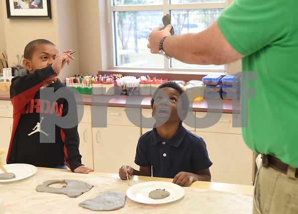 Jalan Donnell, 6, and Kaidan Johnson, 6, make clay turkeys during George Brigman's art class at Bonner Elementary School to celebrate Thanksgiving Thursday Nov. 17, 2016.  (Sarah A. Miller/Tyler Morning Telegraph)