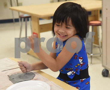 Isabella Alutaya, 5, flattens her clay before making it into a  turkey during George Brigman's art class at Bonner Elementary School to celebrate Thanksgiving Thursday Nov. 17, 2016.  (Sarah A. Miller/Tyler Morning Telegraph)