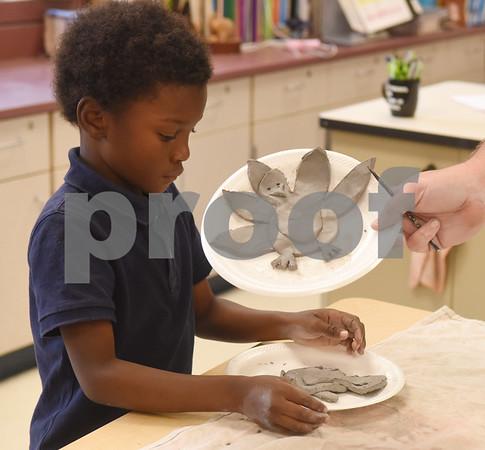 Kaidan Johnson, 6, makes a clay turkey during George Brigman's art class at Bonner Elementary School to celebrate Thanksgiving Thursday Nov. 17, 2016.  (Sarah A. Miller/Tyler Morning Telegraph)