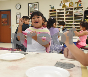 Hadie Martinez, 6, flattens her clay before making it into a  turkey during George Brigman's art class at Bonner Elementary School to celebrate Thanksgiving Thursday Nov. 17, 2016.  (Sarah A. Miller/Tyler Morning Telegraph)