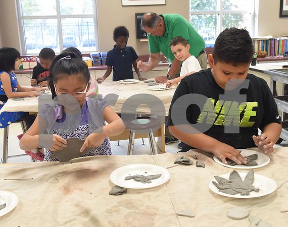 Jacqueline Alvarez, 5, and Daniel Juanchi, 6, make turkeys out of clay during George Brigman's art class at Bonner Elementary School to celebrate Thanksgiving Thursday Nov. 17, 2016.  (Sarah A. Miller/Tyler Morning Telegraph)