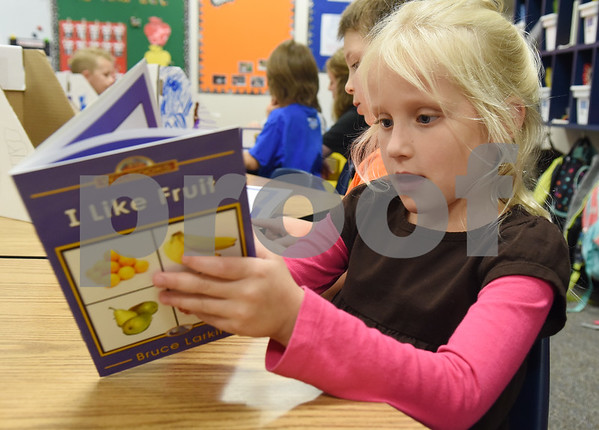 Early Childhood Center kindergartener Sonja Hines, 5, reads her new books that she gets to take home and keep Friday Nov. 18, 2016 as part of the Lindale Books for Kids program. Through this program every kindergarten, first and second grade student will receive 12 books each year.   (Sarah A. Miller/Tyler Morning Telegraph)