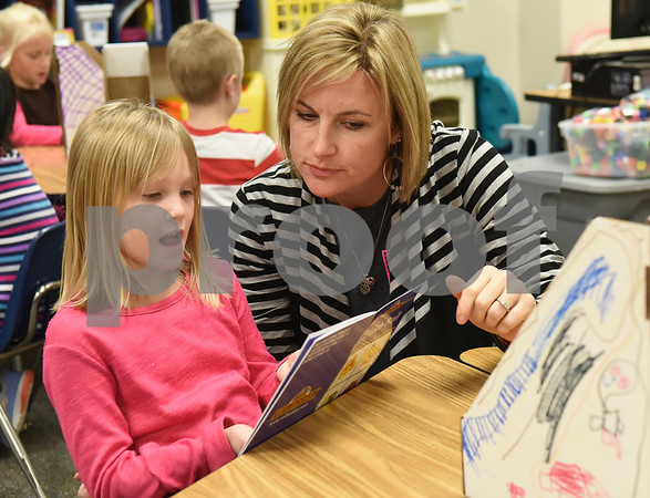 Early Childhood Center kindergarten teacher Angela Shine helps student Danielle Griffin, 5, read a new book she received Friday Nov. 18, 2016 to take home as part of the Lindale Books for Kids program. Through this program every kindergarten, first and second grade student will receive 12 books each year.   (Sarah A. Miller/Tyler Morning Telegraph)