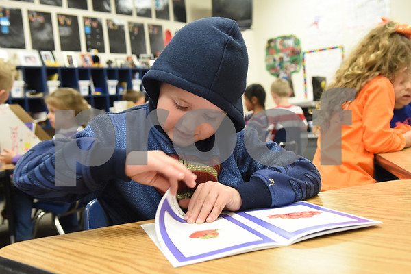 Early Childhood Center kindergartener Hayden Crockett, 6, reads his new book that he gets to take home and keep Friday Nov. 18, 2016 as part of the Lindale Books for Kids program. Through this program every kindergarten, first and second grade student will receive 12 books each year.   (Sarah A. Miller/Tyler Morning Telegraph)
