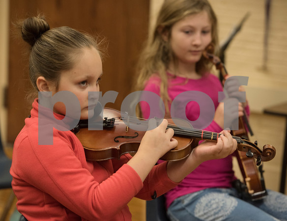 Alyssa Calaway, 9, practices a song during the beginners strings class Wednesday Nov. 1, 2017 at Caldwell Elementary Arts Academy. The class meets before school.  (Sarah A. Miller/Tyler Morning Telegraph)
