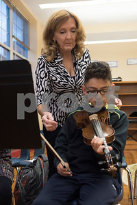 Michelle Frederick helps student Jonathan Bravo, 10, on the violin during the advanced strings class Tuesday Oct. 24, 2017 at Caldwell Elementary Arts Academy.  (Sarah A. Miller/Tyler Morning Telegraph)