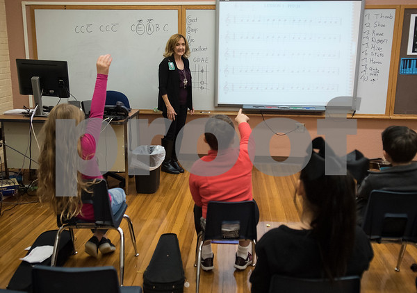 Michelle Frederick asks students to play a line on their own during the beginning strings class Wednesday Nov. 1, 2017 at Caldwell Elementary Arts Academy. The class meets before school.  (Sarah A. Miller/Tyler Morning Telegraph)
