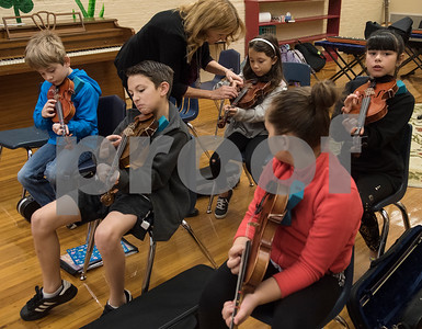 "Michelle Frederick helps student Kianna Sanchez, 9, play through ""Jingle Bells"" during the beginners strings class Wednesday Nov. 1, 2017 at Caldwell Elementary Arts Academy. The class meets before school.  (Sarah A. Miller/Tyler Morning Telegraph)"