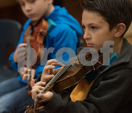 Huntley Keel, 10, plucks a musical phrase during the beginning strings class Wednesday Nov. 1, 2017 at Caldwell Elementary Arts Academy. The class meets before school.  (Sarah A. Miller/Tyler Morning Telegraph)