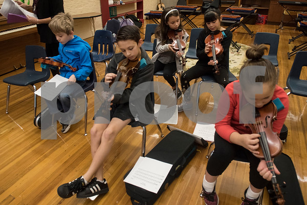 Students practice plucking a song on violins during the beginners strings class Wednesday Nov. 1, 2017 at Caldwell Elementary Arts Academy. The class meets before school.  (Sarah A. Miller/Tyler Morning Telegraph)