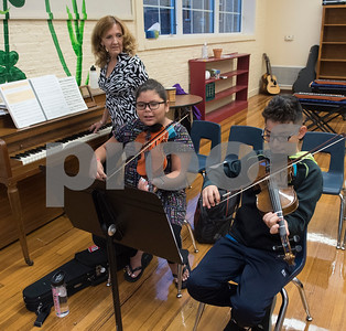 Michelle Frederick teaches students Liliana Valdovinos, 10, and Jonathan Bravo, 10, on the violin during the advanced strings class Tuesday Oct. 24, 2017 at Caldwell Elementary Arts Academy.  (Sarah A. Miller/Tyler Morning Telegraph)