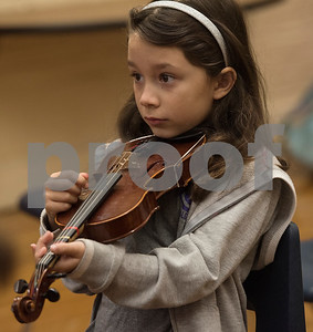 """Student Kianna Sanchez, 9, plucks the notes to """"Jingle Bells"""" during the beginners strings class Wednesday Nov. 1, 2017 at Caldwell Elementary Arts Academy. The class meets before school.  (Sarah A. Miller/Tyler Morning Telegraph)"""