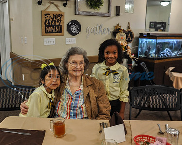 """(From left to right) Brisa Borco, 8, Marilyn Powers, 74, and Haylie Dean, 8, stop for a photo during a """"Lunch & Learn"""" event put on by the Jacksonville ISD Student Ambassador Team on Thursday, November 8. The event took place a Angelina House is Jacksonville where students had lunch with residents and shared stories about their school. (Jessica T. Payne/Tyler Morning Telegraph)"""