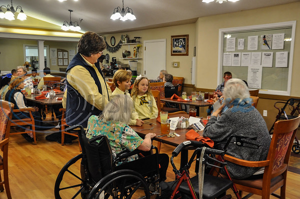 """The Jacksonville ISD Student Ambassador Team visited residents at Angelina House in Jacksonville for a """"Listen & Learn"""" lunch. The team consisted of 21 students grade 3 through 12 who had lunch with residents and shared stories about their school. (Jessica T. Payne/Tyler Morning Telegraph)"""