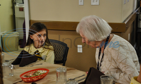 """Jacksonville student Aubrey Lake, 8, (left) chats with Bobbie Simpson, 91, (right) during a """"Listen & Learn"""" lunch at Angelina House in Jacksonville on Thursday, November 8. The lunch was a part of the Jacksonville ISD Student Ambassador Team's monthly outings. (Jessica T. Payne/Tyler Morning Telegraph)"""