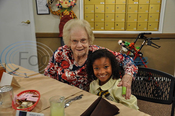 """Angelina House resident Doris Hendrick, 85, (left) and Jacksonville student Haylie Dean, 8, (right) are all smiles during a """"Listen & Learn"""" event put on by the Jacksonville ISD Student Ambassador Team. The lunch was a part of the team's monthly community outings. (Jessica T. Payne/Tyler Morning Telegraph)"""