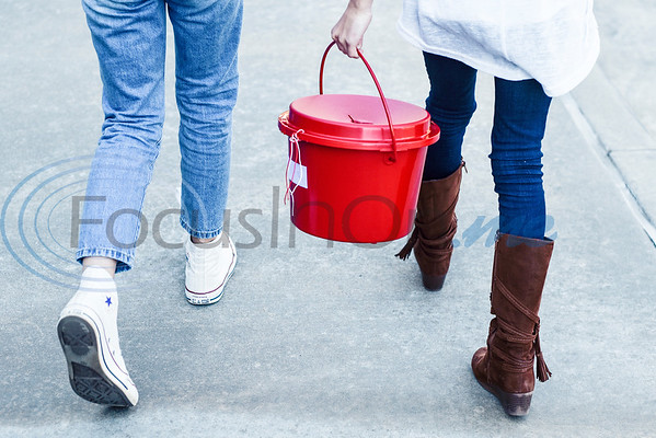 Lilly Bouldin and Bailey Parsons, both 10, collect donations after school as parents come to pick up their children for a fifth grade fundraiser in partnership with the Salvation Arm at Andy Woods Elementary in Tyler, Texas, on Monday, Dec. 10, 2018. (Chelsea Purgahn/Tyler Morning Telegraph)