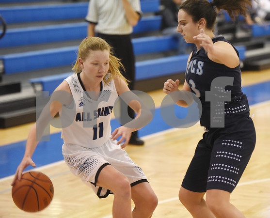 All Saints Episcopal School's (11) Hannah Widman dribbles her way around Prince of Peace's Chloe Johnson during their game Thursday Dec. 1, 2016 in the Bruce G. Brookshire Classic.  (Sarah A. Miller/Tyler Morning Telegraph)