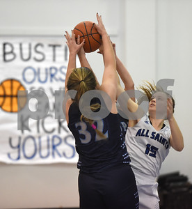 All Saints Episcopal School's Hannah Huckabee competes for control of the ball with Prince of Peace's Alexis Villarreal  during their game Thursday Dec. 1, 2016 in the Bruce G. Brookshire Classic.  (Sarah A. Miller/Tyler Morning Telegraph)