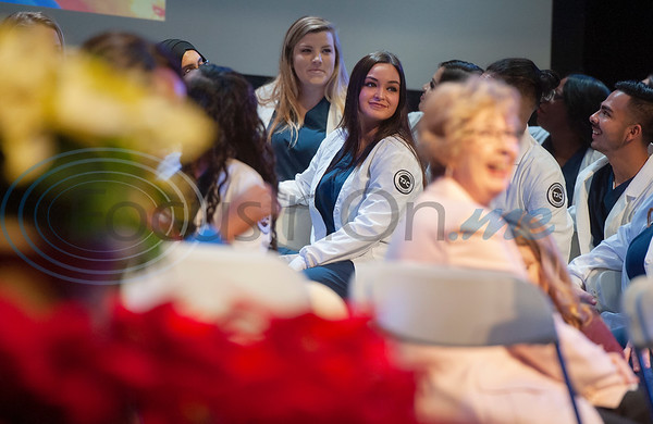 Tyler Junior College nursing student Morgan Thomas, center, smiles during the rehearsal for the Vocational Nursing pinning ceremony at Wise Auditorium on Wednesday Dec. 12, 2018.   (Sarah A. Miller/Tyler Morning Telegraph)