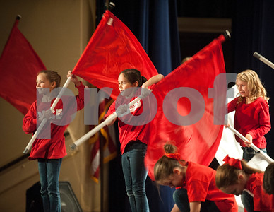 Students from Rice Elementary School do a flag routine during the Tyler ISD Physical Education Showcase held at Caldwell Auditorium Tuesday Jan. 26, 2016.  (Sarah A. Miller/Tyler Morning Telegraph)
