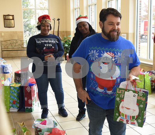 Trane employee Steven Hauck hands out presents at Wayne D. Boshears Center for Exceptional Programs Friday Dec. 9, 2016. Employees from Trane in the IUECWA Local 282 visited students handing out gift bags filled with Christmas presents for each student. Boshears serves students with  severe and profound disabilities.  (Sarah A. Miller/Tyler Morning Telegraph)