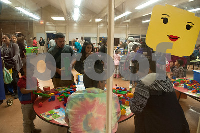 """Families play with Legos during the Tyler ISD Head Start program """"Family Lego Night"""" Thursday at the St. Louis Early Childhood Center.   (Sarah A. Miller/Tyler Morning Telegraph)"""