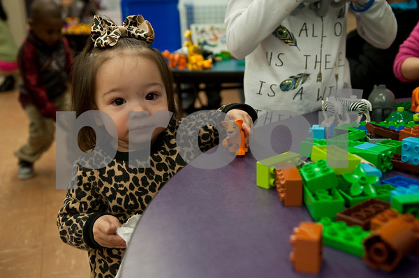 """Delainey Sosa, 1, plays with Legos during the Tyler ISD Head Start program """"Family Lego Night"""" Thursday at the St. Louis Early Childhood Center.   (Sarah A. Miller/Tyler Morning Telegraph)"""