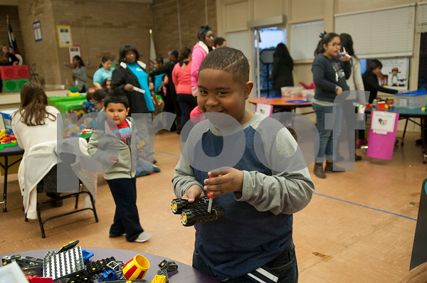 """Marcus Newman, 11, plays with Legos during the Tyler ISD Head Start program """"Family Lego Night"""" Thursday at the St. Louis Early Childhood Center.   (Sarah A. Miller/Tyler Morning Telegraph)"""