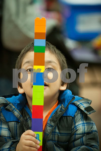 """Alejandro Wilson, 3, plays with Legos during the Tyler ISD Head Start program """"Family Lego Night"""" Thursday at the St. Louis Early Childhood Center.   (Sarah A. Miller/Tyler Morning Telegraph)"""