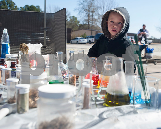 UT Tyler Innovation Academy kindergartener Monnie Bryant, 5, makes a stop at the potions booth at the Renaissance Faire, an event held by UT Tyler Innovation Academy  students to showcase display booths and activities from the medieval period on Tuesday Jan. 30, 2018. The older students taught the younger students using foundational arts and crafts from the medieval period that have evolved into the Science, Technology, Engineering, and Math (STEM).    (Sarah A. Miller/Tyler Morning Telegraph)