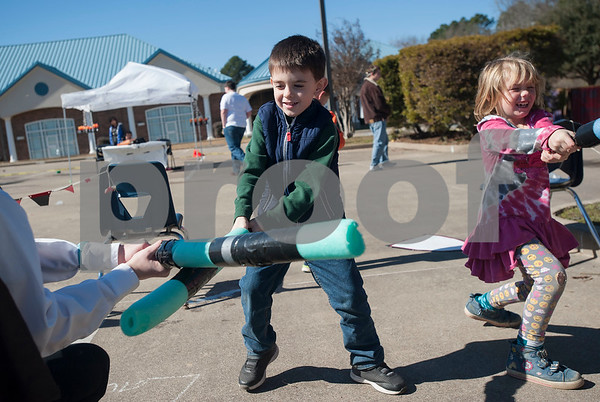 UT Tyler Innovation Academy students Wylder Smith, 6, and Laffy Lee, 6, play fight during their Renaissance Faire on Tuesday Jan. 30, 2018. The older students taught the younger students using foundational arts and crafts from the medieval period that have evolved into the Science, Technology, Engineering, and Math (STEM).    (Sarah A. Miller/Tyler Morning Telegraph)