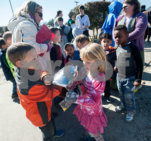 Kindergarteners from the UT Tyler Innovation Academy pass around a helmet as they arrive at the Renaissance Faire, an event held by UT Tyler Innovation Academy  students to showcase display booths and activities from the medieval period on Tuesday Jan. 30, 2018.  The older students taught the younger students using foundational arts and crafts from the medieval period that have evolved into the Science, Technology, Engineering, and Math (STEM).    (Sarah A. Miller/Tyler Morning Telegraph)