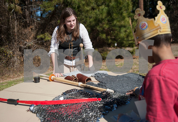 UT Tyler Innovation Academy eight grader Kasey Newsome teachers a younger student about chainmail and practice swords at the Renaissance Faire, an event held by students at the UT Tyler Innovation Academy to showcase display booths and activities from the medieval period on Tuesday Jan. 30, 2018.  The older students taught the younger students using foundational arts and crafts from the medieval period that have evolved into the Science, Technology, Engineering, and Math (STEM).    (Sarah A. Miller/Tyler Morning Telegraph)