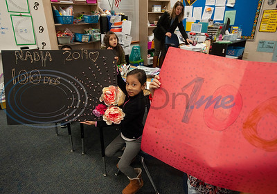Griffin Elementary School first grader Nadia Flores, 7, made a poster with 100 beans on it to celebrate the 100th day of school on Wednesday Jan. 30, 2019.  (Sarah A. Miller/Tyler Morning Telegraph)