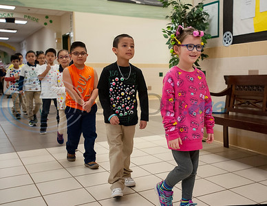 Douglas Elementary School student Alice Williams wears rollers in her hair like a 100-year-old person would as she celebrates the 100th day of school with a parade through the hallways on Wednesday Jan. 30, 2019.  (Sarah A. Miller/Tyler Morning Telegraph)