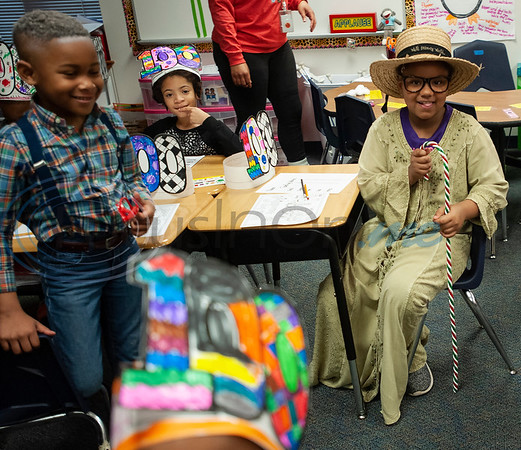 Griffin Elementary School first grader I'Liyah McGill, 7, at right, dresses up as a 100-year-old woman to celebrate the 100th day of school on Wednesday Jan. 30, 2019.  (Sarah A. Miller/Tyler Morning Telegraph)