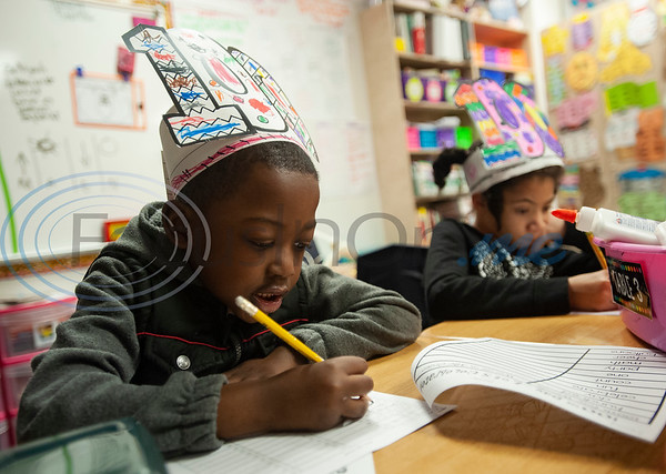 Griffin Elementary School first graders Gabriel Smith, 6, and Aiesha Thompson, 8 work to write down 100 items in their classroom to celebrate the 100th day of school on Wednesday Jan. 30, 2019.  (Sarah A. Miller/Tyler Morning Telegraph)
