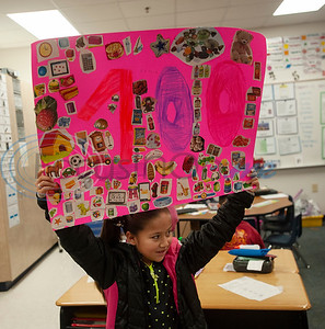 Griffin Elementary School first grader Camila Arteaga, 7,  made a poster with 100 cut out items from a magazine on it to celebrate the 100th day of school on Wednesday Jan. 30, 2019.  (Sarah A. Miller/Tyler Morning Telegraph)