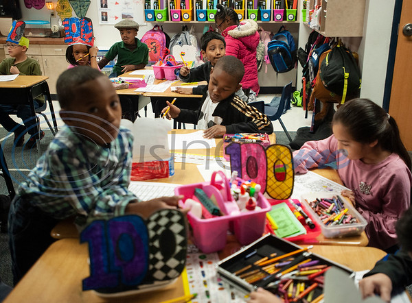 Griffin Elementary School first graders work to write down 100 items in their classroom to celebrate the 100th day of school on Wednesday Jan. 30, 2019.  (Sarah A. Miller/Tyler Morning Telegraph)