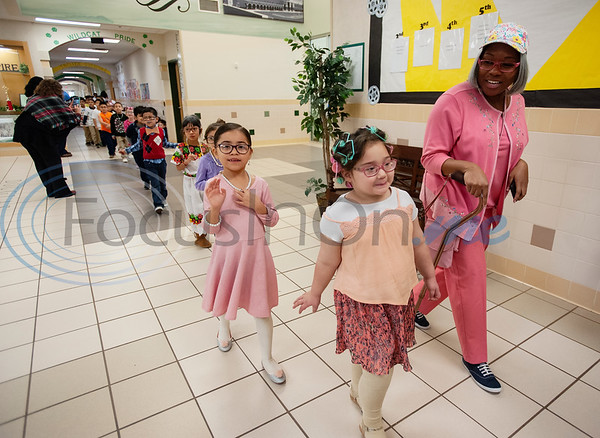 Douglas Elementary School kindergarten teacher Diamond Green dresses as a 100-year-old along with several students to celebrate the 100th day of school with a parade through the hallways on Wednesday Jan. 30, 2019.  (Sarah A. Miller/Tyler Morning Telegraph)
