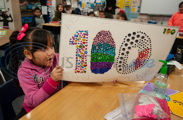 Griffin Elementary School first grader Yanitzy Ruiz, 7, made a poster to celebrate the 100th day of school on Wednesday Jan. 30, 2019.  (Sarah A. Miller/Tyler Morning Telegraph)