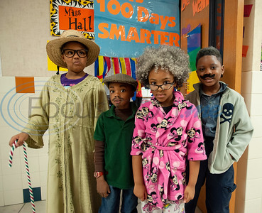 Griffin Elementary School first graders I'Liyah McGill, 7, Kasun Black, 7, Jasmin Green, 6, and Ketrayvais Williams, 9, dress up as 100-year-old people to celebrate the 100th day of school on Wednesday Jan. 30, 2019.  (Sarah A. Miller/Tyler Morning Telegraph)
