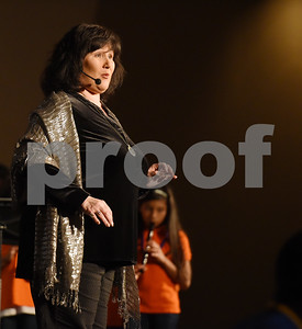 Tyler ISD music teacher Cynthia Dempsy sings with the East Texas Symphony Orchestra during an event with Tyler ISD fourth and fifth graders called The Orchestra Sings Tuesday Jan. 31, 2017 at Caldwell Auditorium.  (Sarah A. Miller/Tyler Morning Telegraph)