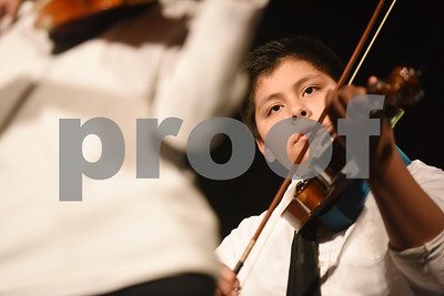 Caldwell Elementary School fourth grader Adrian Ocampo plays the violin with the East Texas Symphony Orchestra during an event with Tyler ISD fourth and fifth graders called The Orchestra Sings Tuesday Jan. 31, 2017 at Caldwell Auditorium.  (Sarah A. Miller/Tyler Morning Telegraph)