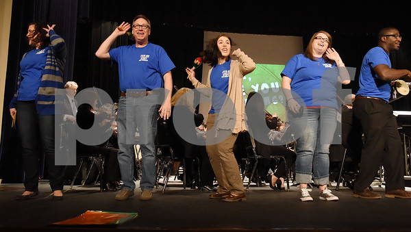 Tyler ISD staff members sing and dance with the East Texas Symphony Orchestra during an event with Tyler ISD fourth and fifth graders called The Orchestra Sings Tuesday Jan. 31, 2017 at Caldwell Auditorium.  (Sarah A. Miller/Tyler Morning Telegraph)