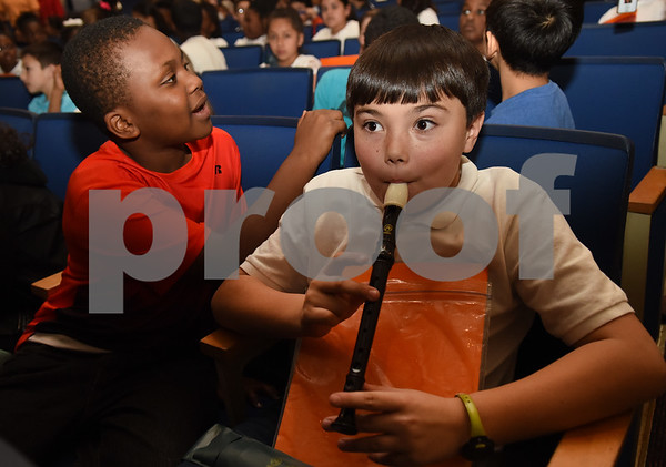 Fourth grader Joshua Meadows plays his recorder with the East Texas Symphony Orchestra during an event with Tyler ISD fourth and fifth graders called The Orchestra Sings Tuesday Jan. 31, 2017 at Caldwell Auditorium.  (Sarah A. Miller/Tyler Morning Telegraph)